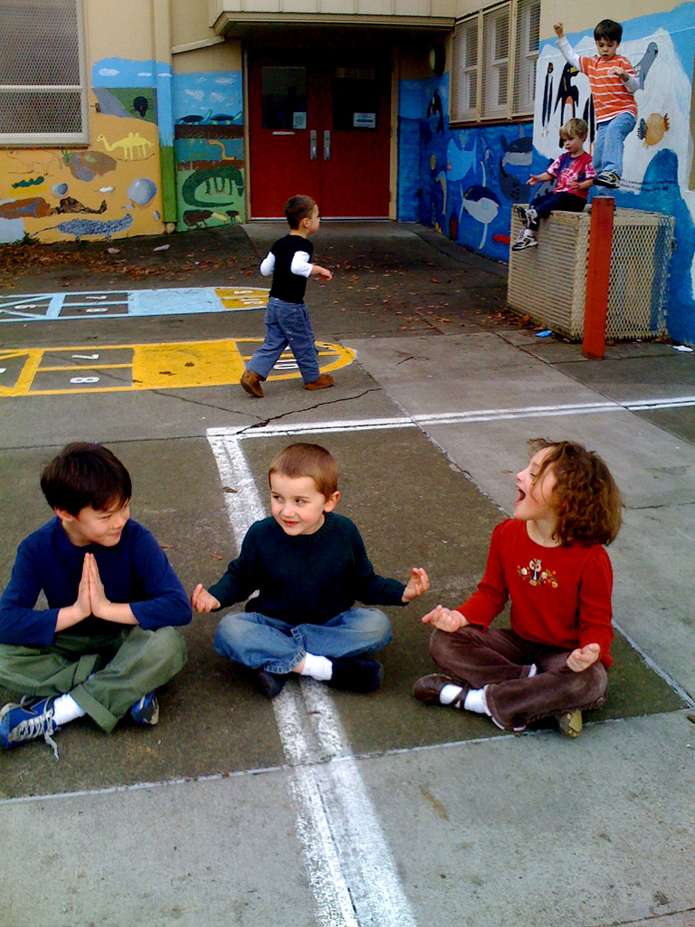 These kids don't look like they need any help focusing on the present moment - having fun playing with each other!