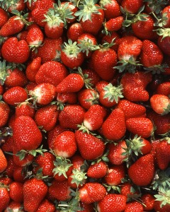 A large strawberry contains about 1 gram of natural sugar. They are low in sugar, unless you dip them in sugar before giving them to your kids.